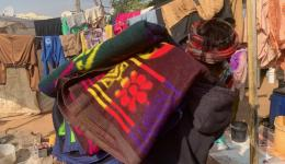 Distribution of blankets in slum areas ...