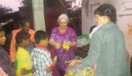 In the village of Ram Krishna children enjoy the bananas brought along.