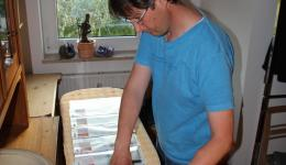 Frank preparing the travel documents for the team.