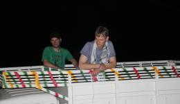 Florian and Jürgen on the loading space of the mini trucks on the way from Patna to Raxaul after the Jeep has failed due to a technical defect in the electronics.