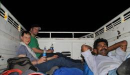 Florian, Jürgen and our Indian friend Ramavarai on the loading space of the open mini truck.