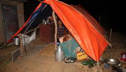 Under plastic tarps as protection against the heavy rain.