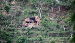 ... then the old man sadly shows his completely destroyed house on the other side of the mountain. When the house collapsed his arm was broken.