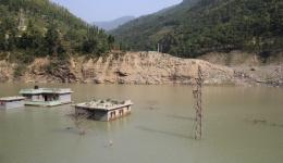 Due to landslides this river dammed and flooded houses.
