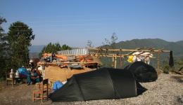 """During the camp we are using the tents ourselves, afterwards they are given away. In this photo, the right tent still stands between the bamboo poles of the medical """"receiving station""""."""