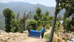 Raz, a young man who had offered us his help in Charikot and Prabhu, our electrician who provides power, carry the medical accessories in the big metal boxes that Florian and Alexandra had bought in Birgunj, to the medical tent. 2