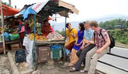 Day 2 - May 12, 2016 - Kathmandu, journey to and arrival in Jareber. A car breakdown gives us time to talk to the friendly fruit woman. She cuts a mango and passes the pieces on to us on small wooden sticks.