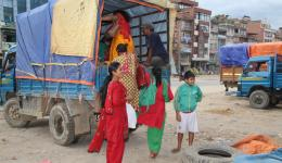 After the purchases, the residents climb into the small truck with the materials to return to their villages...