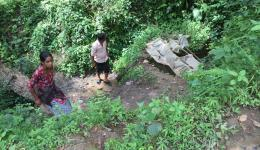 """Many Dalit families (""""caste of untouchables""""), who have a particularly hard life, show us a source from where water can be pumpted through a pipe system to reservoirs near the houses."""