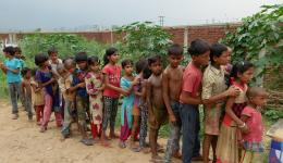 Distribution of fruits, biscuits, mosquito nets, toothbrushes etc. in poor areas of India.