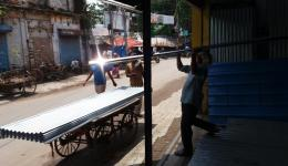 Purchasing corrugated iron roofs in Allahabad.