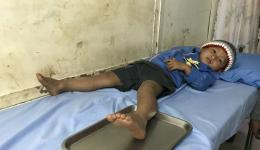 This boy has shortly before injured his foot on a nail. We take him to the medical station.