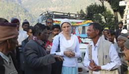 Greeting and preparational talk in the fourth village high up in the mountains. The village magistrate is discussing with Venu. The names  will then be announced through a megaphone.