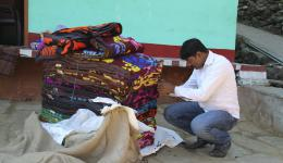 Our driver is helping dilligently all the time. Here he is opening a new pack of blankets.