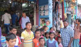 Shopping with children of the Chakia colony.