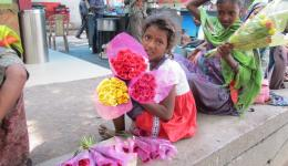 The children have come to the city from villages in Rajastan. They earn their living by selling flowers on the streets.