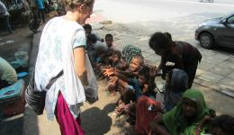 These children are living under a nearby bridge and are delighted to get a warm meal and juice.