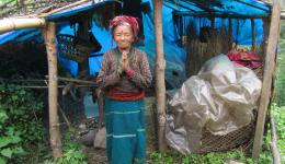 This old woman is living alone in this hut.