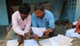 Carefully applications for power supply are filled in and submitted to the local authorities. On the right: Ramavaraj, project manager of FriendCircle WorldHelp for several leprosy villages in the state of Bihar.