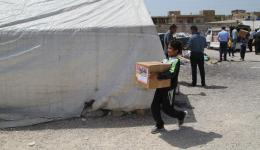 Distributing the packages in the refugee camps in the Bekaa plain.
