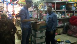 Michael and our friend Ahmed selecting school material in a shop in Beirut.