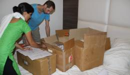 Before the departure into the mountains to the planned medical camp, medicine is diligently sorted and packaged in boxes.