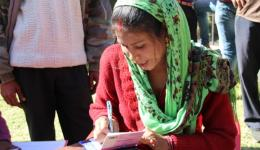 Manju writes down the name and age of the patients and distributes numbers to call each one in turn.
