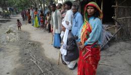 The people of the leprosy village Bhairoganj. Young and old are waiting for Ashok to distribute sweets...