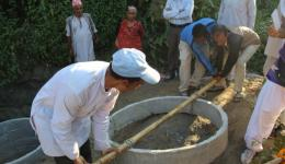 Completion of the well with concrete ring lining in Methinkot, Nepal.