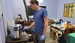 Tobias using the sterilization pot for the disinfection of the operating equipment.