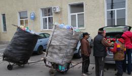 Garbage collectors with their self-built vehicles.