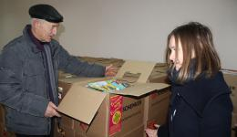 Nicolai Melnic and Cristina. The packages are carefully stacked and waiting for distribution. The schedule for Jan. 7, 2015: Discuss the list, distribute the packages at the City Hall, visit some families. Let's get started ;-)