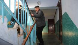 Nicolai, the mayor of Calarasi, and Frank carry the packet up  the stairwell ...