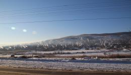 Jan. 8, 2015 - Departure. Still minus 20 ° C in the morning. The car starts up only at the fourth attempt. The long return journey starts and we enjoy the sun and the beautiful winter landscape. On the photo you can see the many chimneys of a village ...
