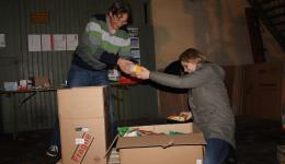 9 packet of goods in kind are received today. Many thanks to the donors! Helena and Frank are repacking the goods into shipping cartons.