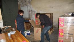 In between donated packets are. Here we see Margarethe bringing several packages from different donors.