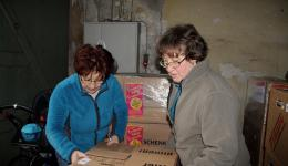 Each carton is carefully positioned so that all are safely on the pallet.