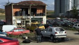 Despite their dilapidated condition, many houses are used. Here is an auto repair shop. Note the roof of the building...
