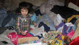 The boy gets a small package with gifts and the family a big parcel with food.