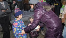 Two girls who are living in poorest conditions with the parents are getting another parcel with gifts.