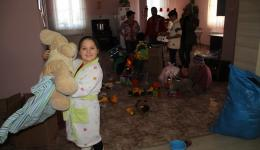 The bathing wrap finds a new owner and the second one is immediately used to to wrap up the teddy bear.