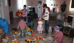 Every one of the three houses is the home of ten children. Later on the gifts are distributed fairly.