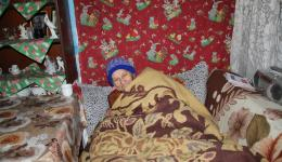 This lady is very happy about the cap. She is bedridden and waiting for an operation on her spine.