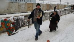 Emil, our friend from Cluj is carrying wood to the home of an old lady who has difficulty to walk.