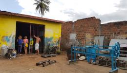 A small forge in Santo Antonio is ordered to manufacture five machines that are needed for the manioc company.