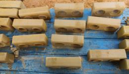 Ready made bricks by manual pressing.
