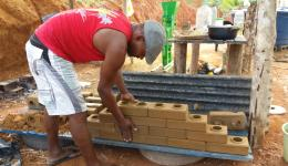As a test, Antonio piling up the finished bricks on top of each other.