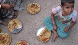 At several places food is distributed to the street children in Delhi.