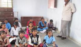 Venu with the schoolchildren in a classroom. In the background you can see the stock boxes with school supplies. Also these were financed by FriendCircle WorldHelp ...