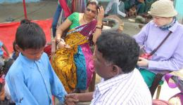 Also here FriendCircle Worldhelp finances tutoring for all students. Katrin and Venu reviewing the learning progress of the children. The tutor (in the colorful sari) sits in the background.